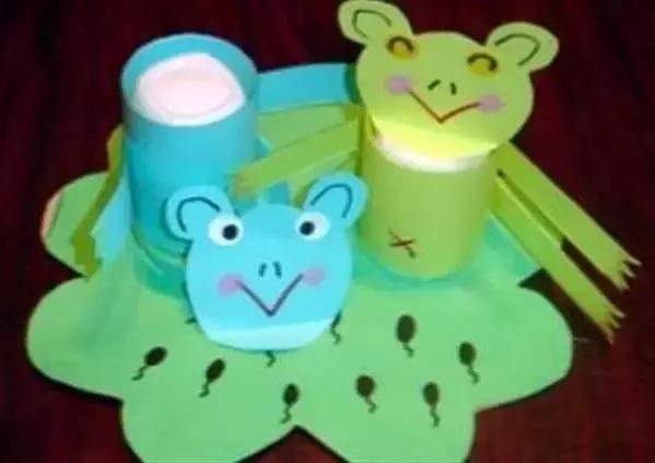 制作方法:   (1)用即时贴将纸盒包装;   (2)用废纸筒装饰再做成动物